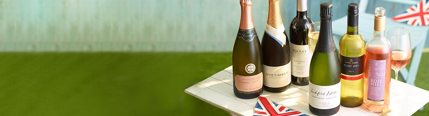Bottles of English wine and sparkling wine on a table.