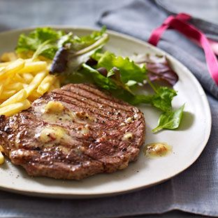 A fine steak with chips and salad