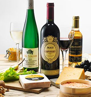 Bottles of wine and cheese