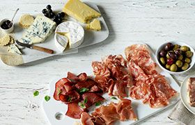 Gourmet deli platters with meats and cheese