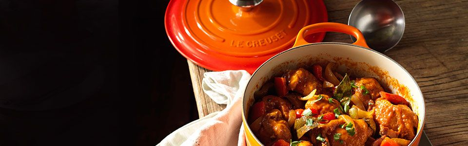 A casserole in an orange Le Creuset pot