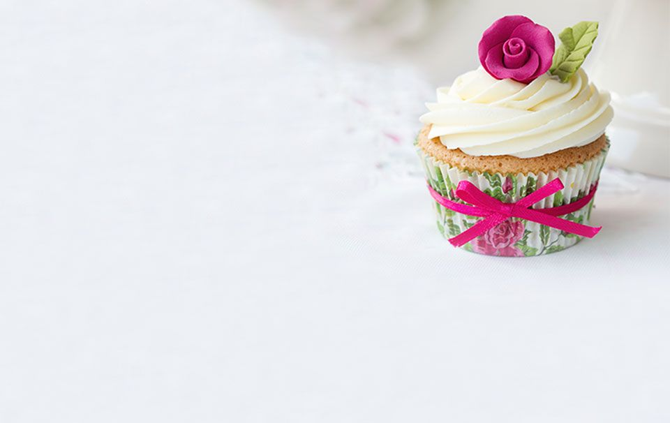 A cupcake with an intricate rose on top