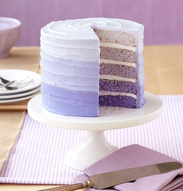 A Layered and iced cake withn gradient coloured icing