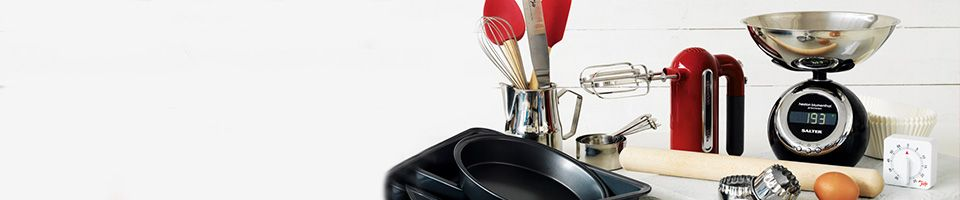 A kitchen scene with utensils gadgets and kitchen appliances
