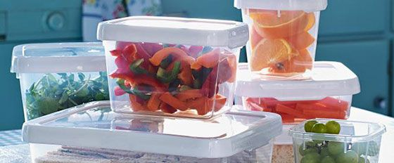 A selection of food containers with fresh fruit inside