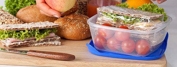 A lunch being prepared and placed in a lunch box