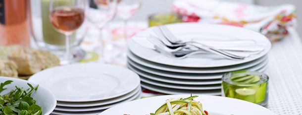 A set of high quality plates and cutlery