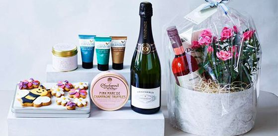 A selection of gifts including chocolate and prosecco