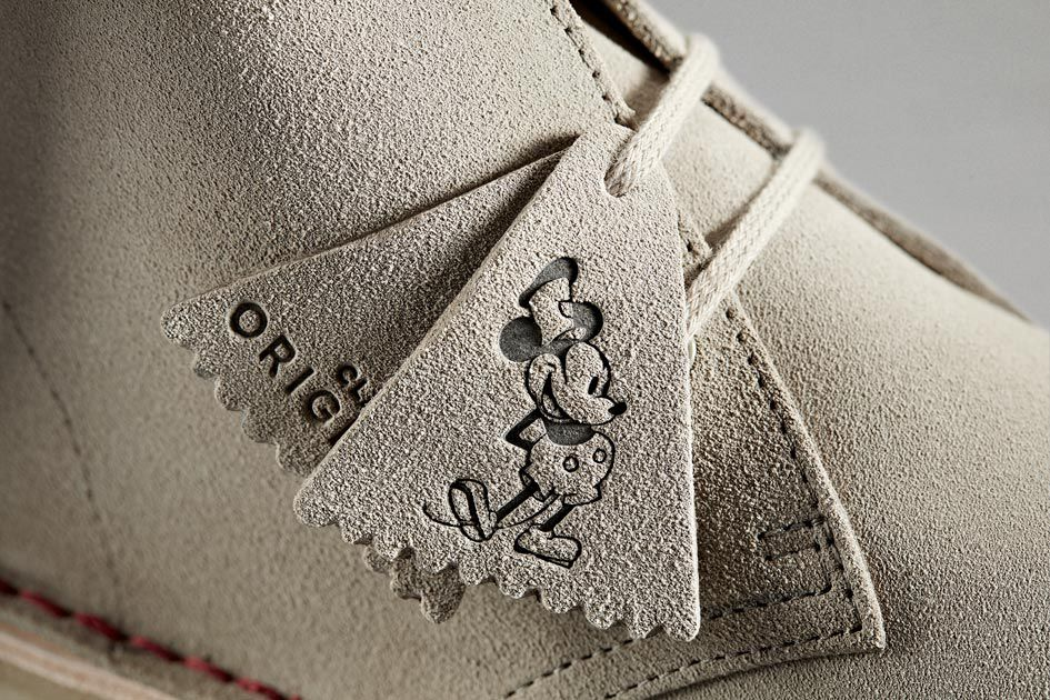 Close-up of the Desert Boot's iconic Original's fob featuring Steamboat Willie