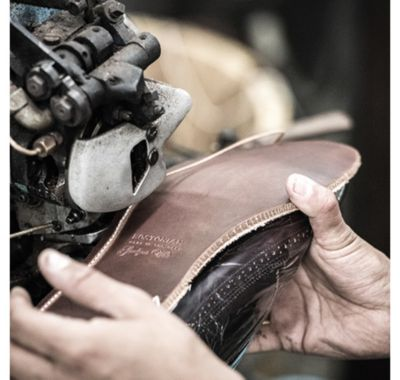 Shoe maker making Clarks shoes in New York