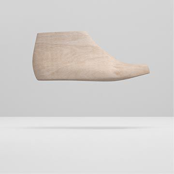 Vista lateral de una horma de madera