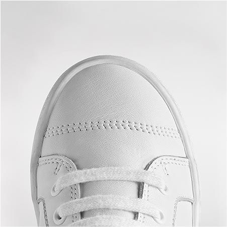 Close-up of the toe of a white trainer