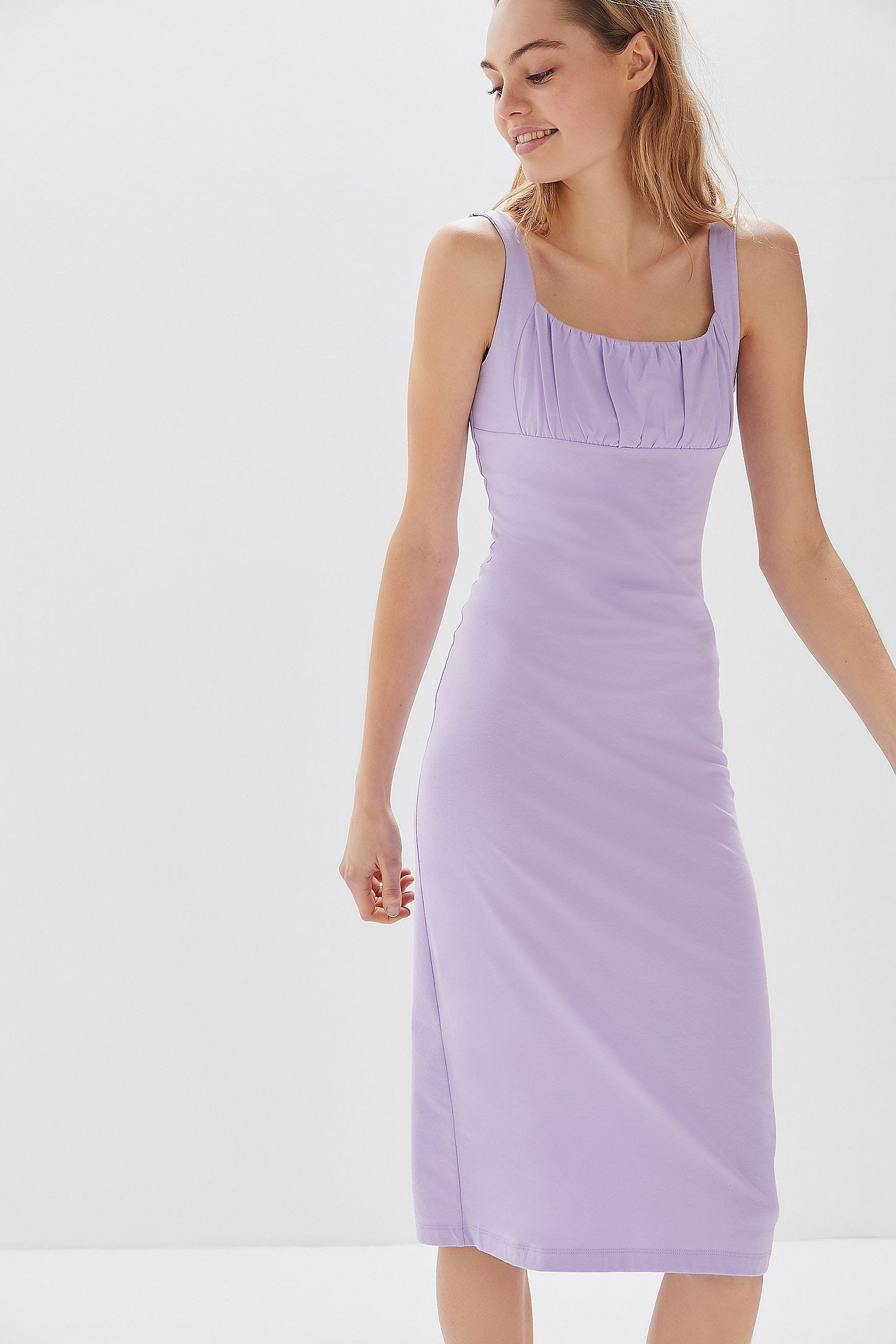 8f677c62858a8 UO Geneva Ruched Empire Waist Midi Dress. Click on image to zoom. Hover to  zoom. Double Tap to Zoom