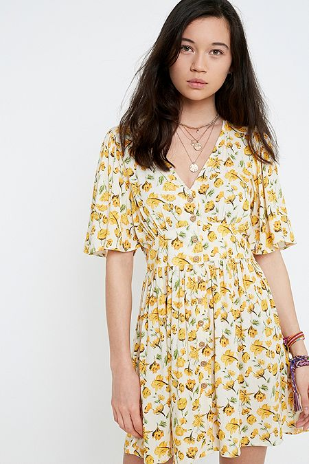 baab9f55f5a52d UO Yellow Floral Primrose Mini Dress