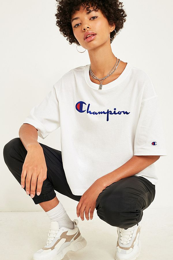 31a58222062f Champion Oversized White Logo Script Crop T-Shirt | Urban Outfitters UK