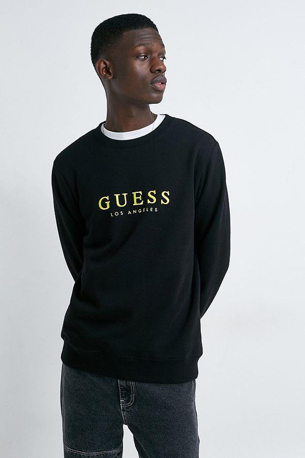 GUESS Originals UO Exclusive – Sweatshirt mit Rundhalsausschnitt in Schwarz mit goldenem Logo