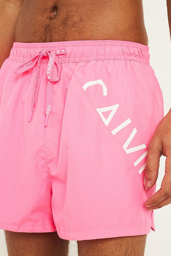 7a03e925bc Calvin Klein Core Diagonal Logo Pink Swim Shorts   Urban Outfitters UK