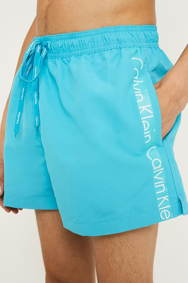 12c276f5a3 Calvin Klein Taped Blue Swim Shorts | Urban Outfitters UK