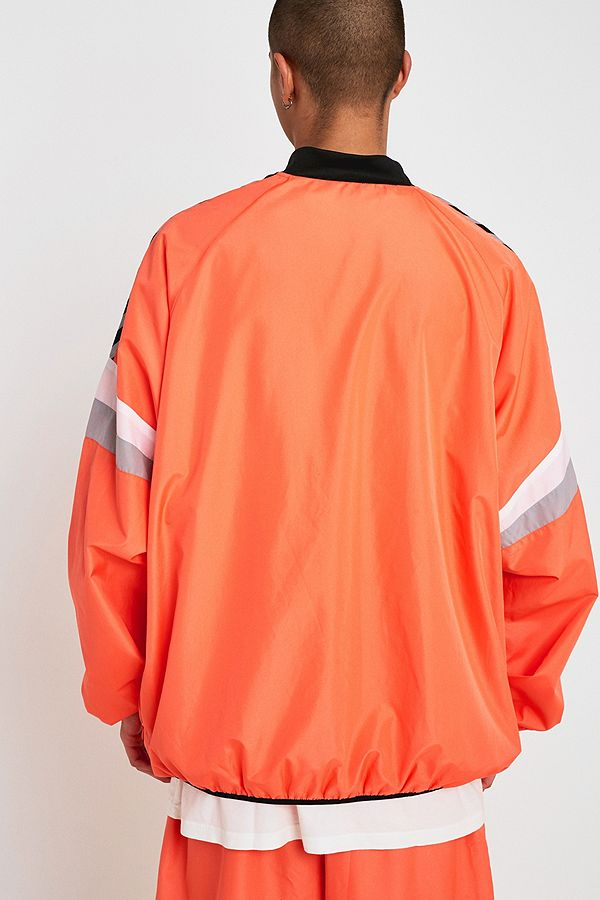 online retailer 0ea04 3e325 Slide View  4  Hummel X Willy Chavarria Orange Windbreaker Jacket