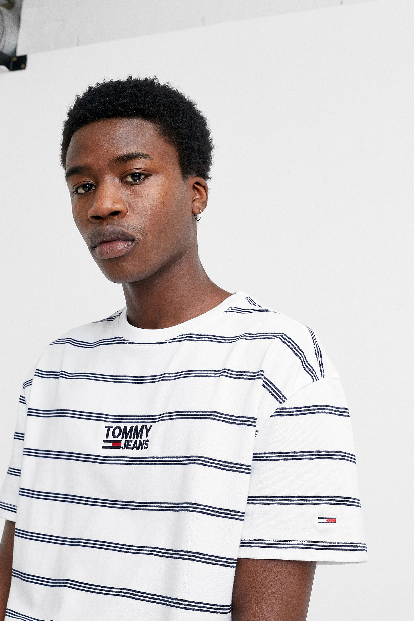 96ec7a679a Tommy Jeans White Signature Stripe T-Shirt. Click on image to zoom. Hover to  zoom. Double Tap to Zoom