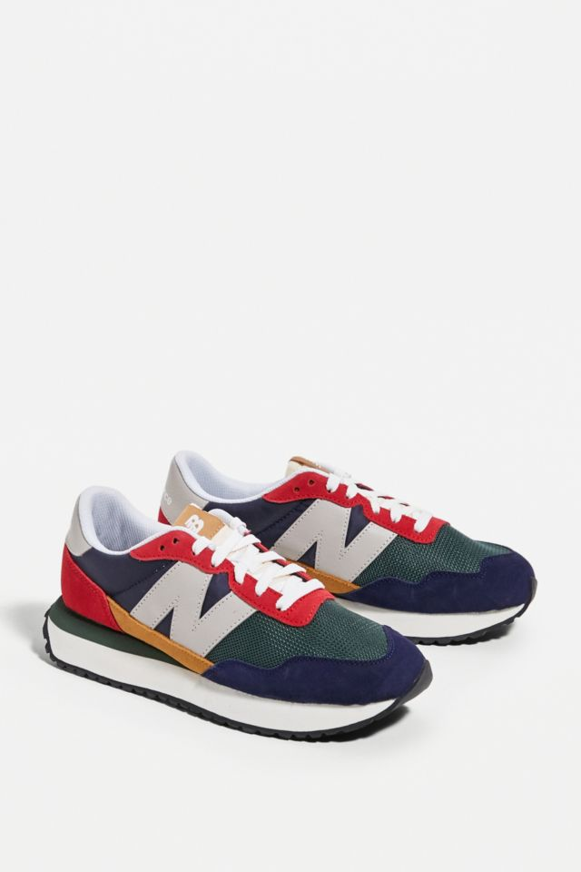 New Balance 237 Multicoloured Trainers in green, blue, yellow and red.