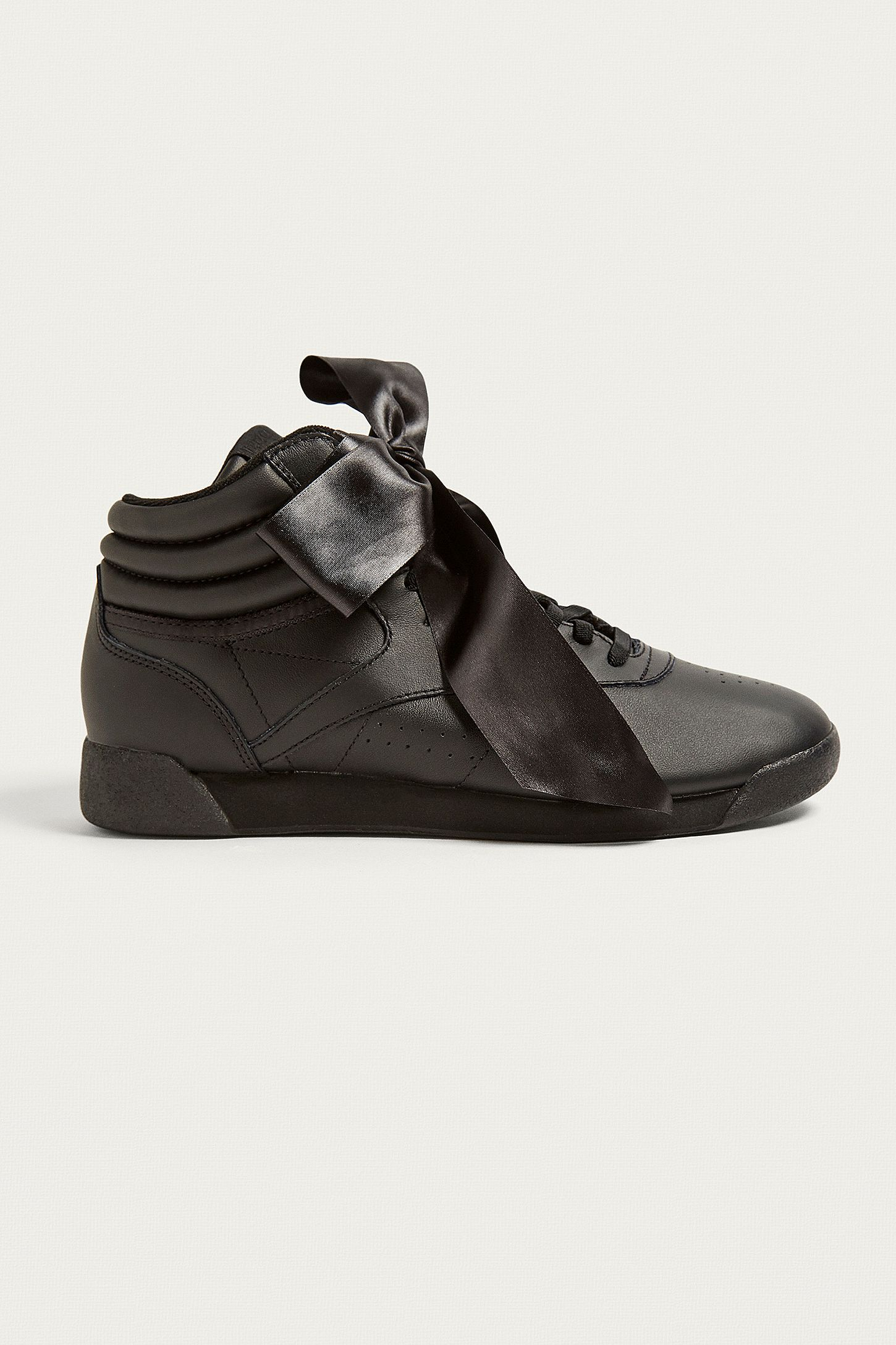 1dc6f10e85866 Reebok Freestyle Hi Black Satin Bow Trainers. Click on image to zoom. Hover  to zoom. Double Tap to Zoom