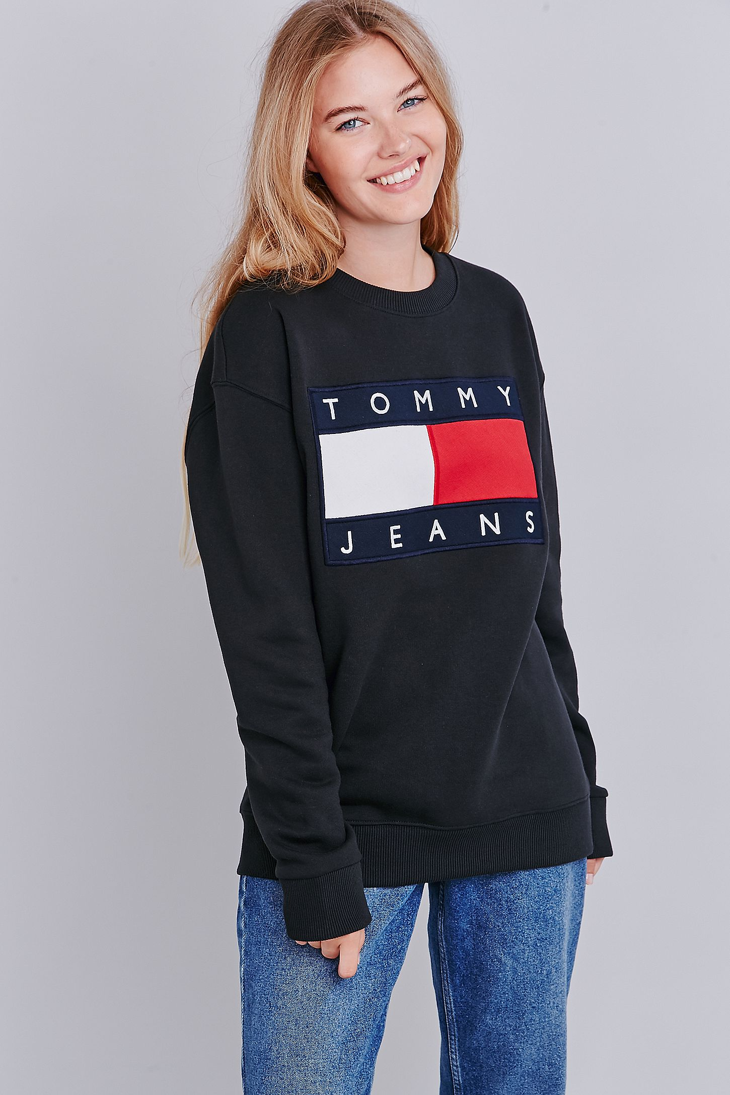 a6950df1 UO Exclusive Tommy Jeans Black Crew Neck Sweatshirt | Urban ...