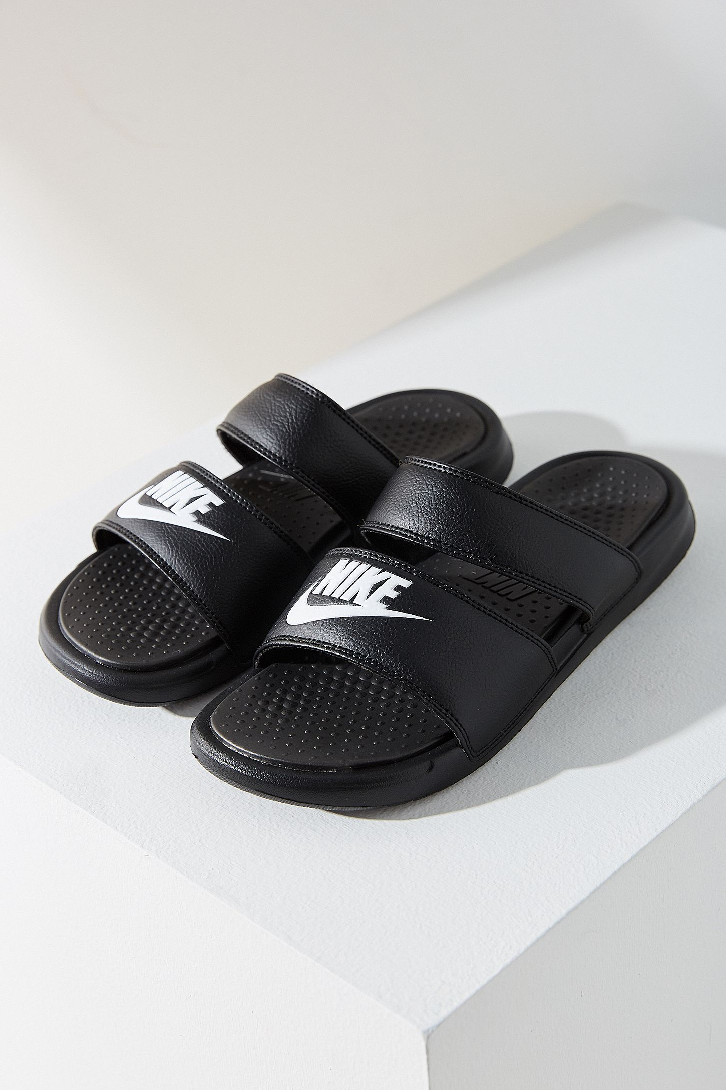 pretty nice c3a81 ab9aa Nike Benassi Duo Ultra Slides. Click on image to zoom. Hover to zoom.  Double Tap to Zoom