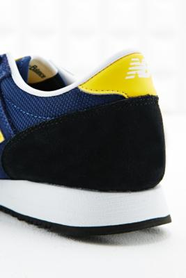 new balance 620 runner trainers in navy and yellow