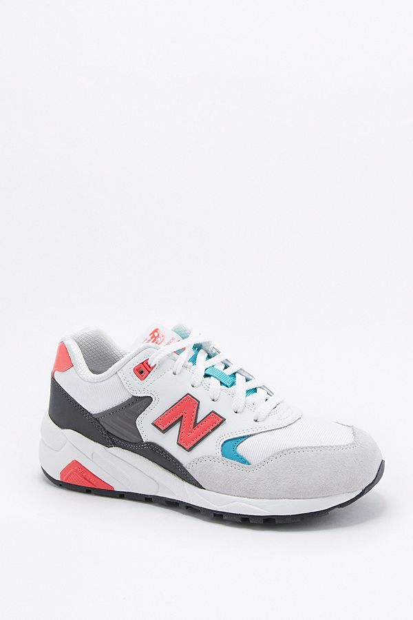 wholesale dealer 553cf 2d051 New Balance 580 White and Coral Running Trainers