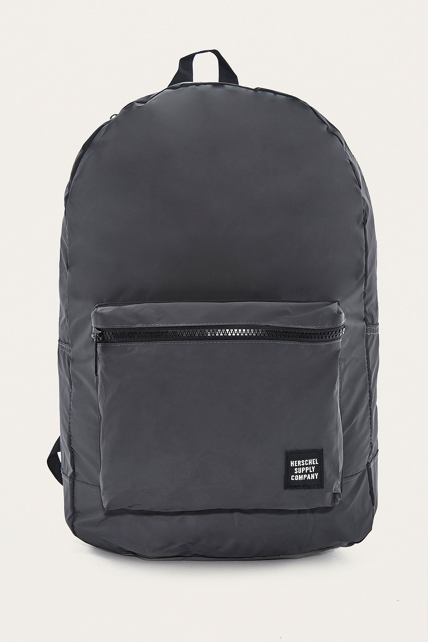 fb1b5d7d489 Herschel Supply Co. Reflective Black Packable Daypack Backpack. Click on  image to zoom. Hover to zoom. Double Tap to Zoom