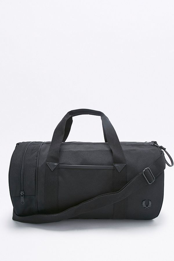 3b9fac4698 Fred Perry Small Black Nylon Barrel Bag | Urban Outfitters UK