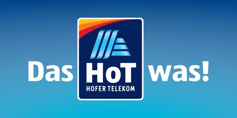 """Auf blauem Hintergrund steht der weiße Schriftzug """"Das HoT was"""". In der Mitte das Logo von HoT."""