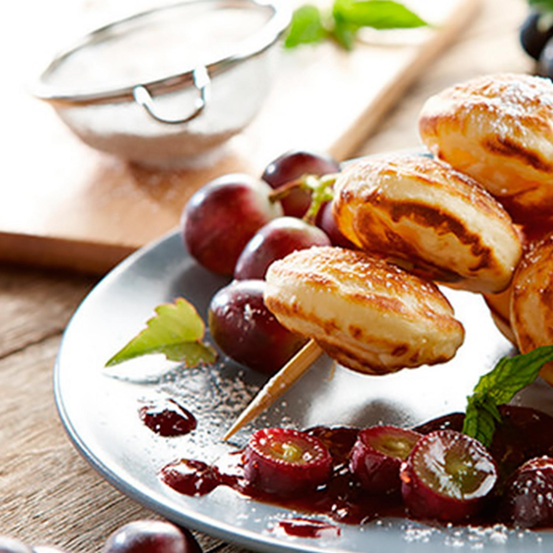 Poffertjes mit karamellisierten Trauben