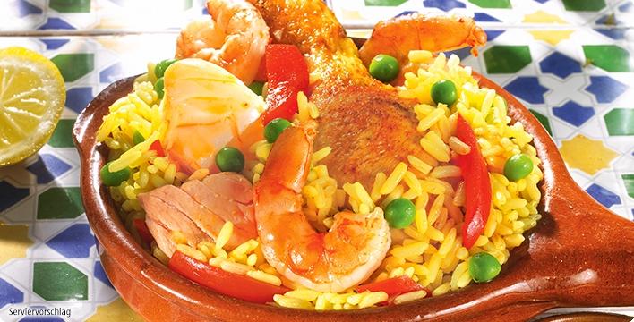 Paella mit Riesengarnelen und Fisch