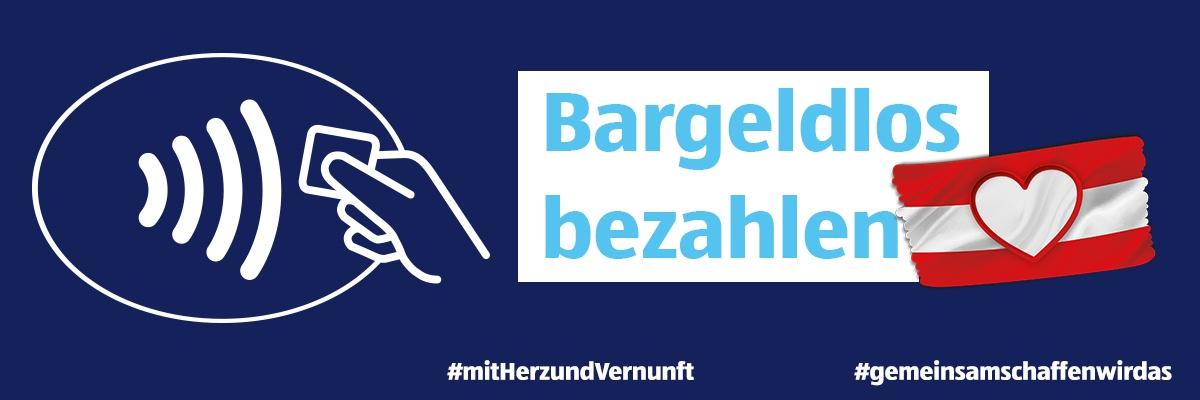 Ein dunkelblauer Hintergrund mit dem Hinweis Bargeldlos bezahlen.