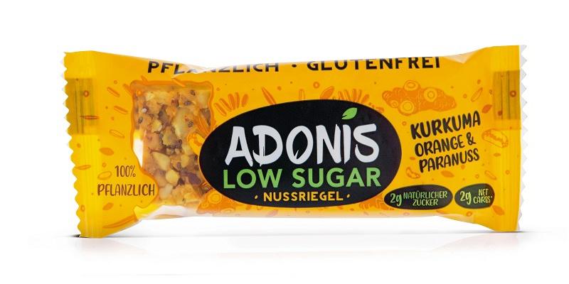 Ein AODNIS Low Sugar Riegel in der Geschmacksrichtung Kurkuma, Orange und Paranuss.
