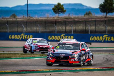 A picture of Hyundai Motorsport's i30 N TCR in action on a racetrack.