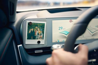 A family photo attached to the digital cluster of a Hyundai IONIQ 5 midsize electric CUV.