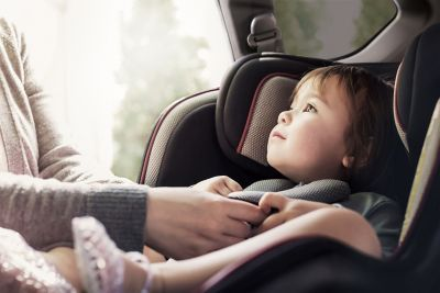 A child sitting in the back of the new Hyundai Santa Fe 7 seat SUV with the rear occupant alert.