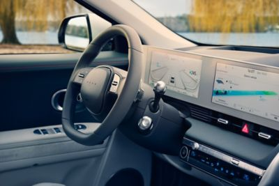 The interior of the Hyundai IONIQ 5 midsize electric CUV showing the steering wheel and digital cluster.