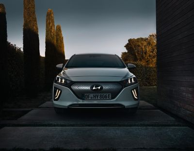 Picture of thenew Hyundai IONIQ Electric parked on the street.