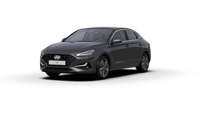 Front side view of the new Hyundai i30 Fastback in the colourDark Knight Grey.