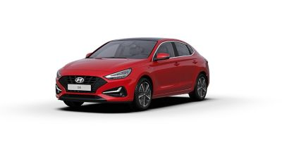 Front side view of the new Hyundai i30 Fastback in the colourEngine Red.