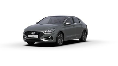 Front side view of the new Hyundai i30 Fastback in the colour Olivine Grey.