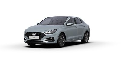 Front side view of the new Hyundai i30 Fastback in the colourPlatinum Silver Grey.