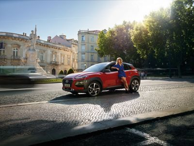 The all-new Hyundai Kona standing on a busy intersection.