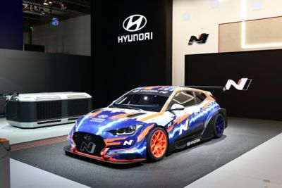 A front view of the Hyundai Veloster N ETCR, the first-ever electric race car by Hyundai Motorsport.