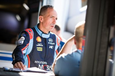Hyundai Motorsport co-driver Carlos del Barrio with hands over a notebook