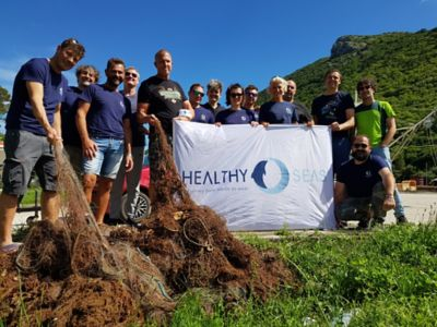 Healthy Seas volunteers with salvaged fishing nets saved from the ocean for recycling.